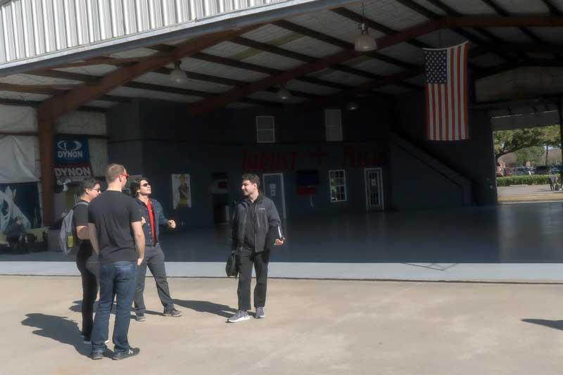 Flight instructors talking in the hangar